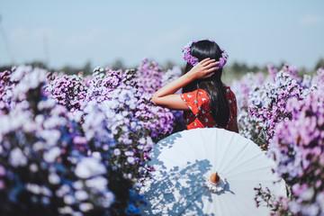 Traveler woman in flower garden