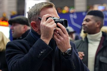 "Actor Daniel Craig takes photos with a Leica camera during a promotional appearance on TV in Times Square for the new James Bond movie ""No Time to Die"" in the Manhattan borough of New York City"