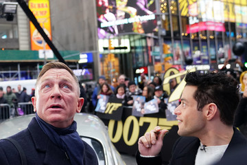"Actors Daniel Craig and Rami Malek talk as they look up at the lights during a promotional appearance on TV in Times Square for the new James Bond movie ""No Time to Die"" in the Manhattan borough of New York City"