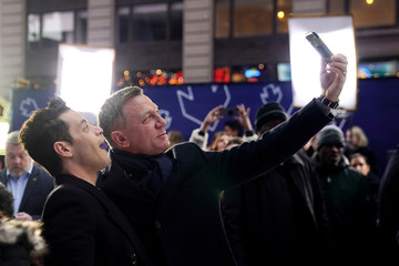 "Actors Daniel Craig and Rami Malek pose for a selfie during a promotional appearance on TV in Times Square for the new James Bond movie ""No Time to Die"" in the Manhattan borough of New York City"