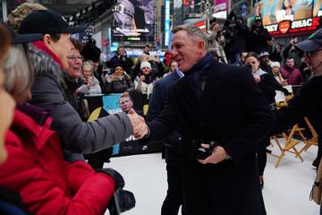 "Actor Daniel Craig shakes hands during a promotional appearance on TV in Times Square for the new James Bond movie ""No Time to Die"" in the Manhattan borough of New York City"