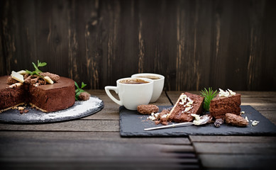 A moment to pause and enjoy the taste, chocolate creamy cake and coffee for pleasure