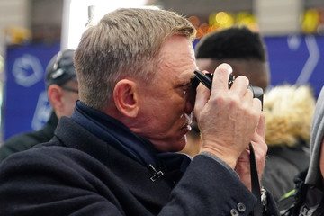 """Actor Daniel Craig takes photos with a Leica camera during a promotional appearance on TV in Times Square for the new James Bond movie """"No Time to Die"""" in the Manhattan borough of New York City"""