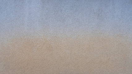 Ombre effect abstract wall texture background. Blue and beige colorful background. Beautiful stone...