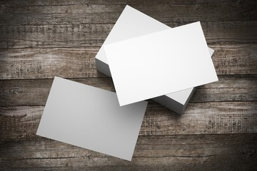 Businesscard (55x85mm) mockup, wooden background - 3D rendering