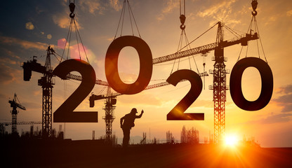 Silhouette construction site,Cranes building construction 2020 year sign Fotomurales