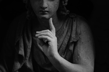 Fototapete - Angel of death makes gesture with finger as if want to say: silentium! Fragment of ancient statue.
