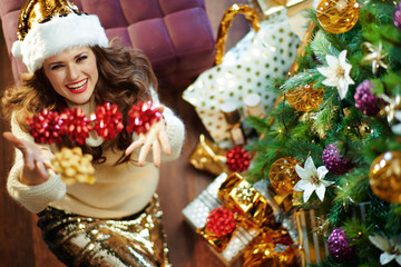 happy modern middle age woman throwing red bows up