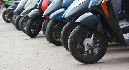 Parked motorbikes on the city street