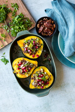 Acorn squash stuffed with quinoa, nuts and vegetables
