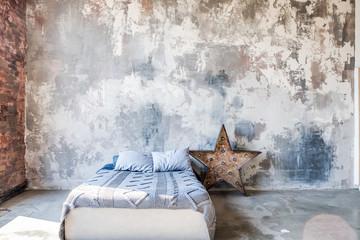 Loft bedroom. Shabby wall. Decortion lamp star shaped