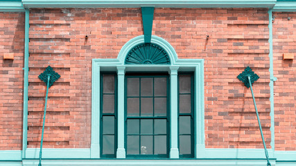 Edwardian style window and building in Sydney, Australia. Blue window on the red brick wall.
