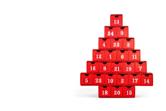 Isolated advent calendar.  Red Christmas tree made cardboard with white numbers. All numbers visible.