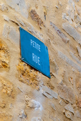 """Street name sign in French town: """"Small Street"""""""