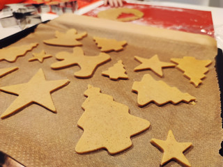 Close up of childs hands making christmas cookies