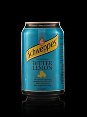 Minsk, Belarus - November 20, 2019: Aluminium can of the Schweppes Bitter Lemon isolated over black background