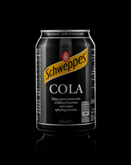 Minsk, Belarus - November 20, 2019: Aluminium can of the Schweppes Cola isolated over black background.
