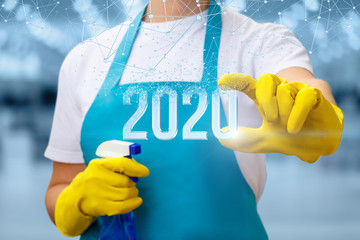 The cleaning lady shows the new 2020 year .