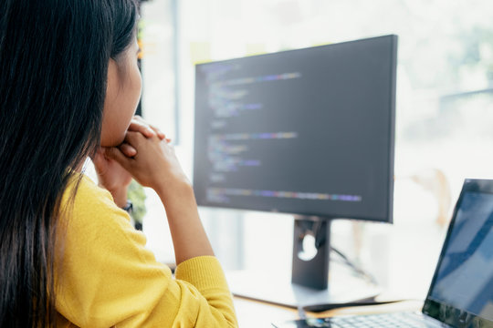 Programmers and developer teams are coding and developing softwa