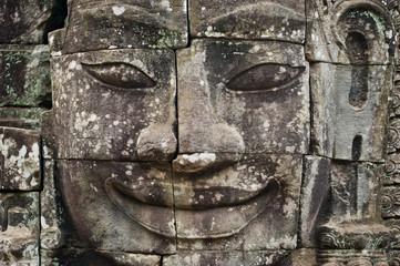 Carved face at Angkor Wat, major historical landmark of Cambodia