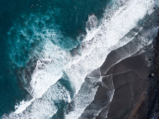 Aerial view of beach and shorelin, waves and surfers
