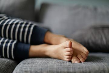 boys feet on sofa