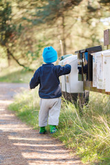 Child checking mail box