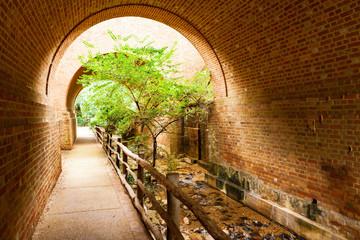 The Pathway Under Bridge Arch at Williamsburg Fotomurales