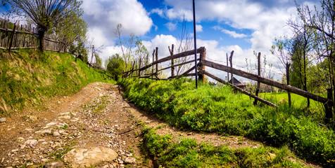 a rural road in the Carpathian village