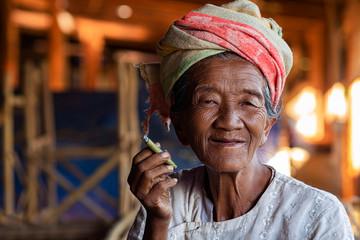 Portrait of Happy Old Burmese Lady Smoking a Cigar at Indein Village Near Inle Lake, Shan State, Myanmar (Burma)