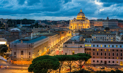 Panoramic night sight in Rome with Saint Peters Basilica, as seen from the Castel Sant'Angelo terrace.