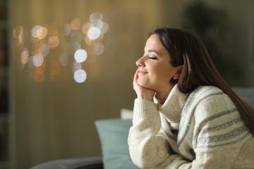 Relaxed woman meditating at home in the night in winter Fototapete