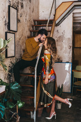 couple kissing inside mediterranean house