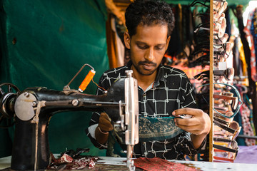 Tailor sewing bag in workshop