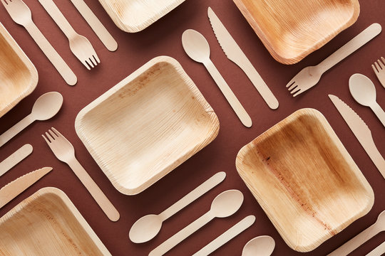 Composition of wooden dishes and cutlery