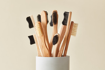 Natural wooden toothbrushes in cup
