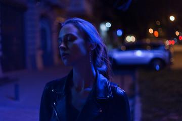 portrait of a girl in a leather jacket in neon light cyberpunk