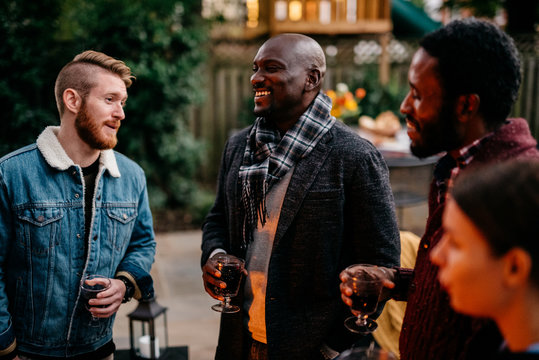 Friends telling jokes during an outdoor get together