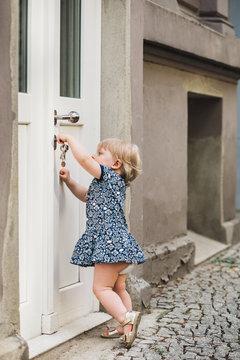 Little kid trying to open a door