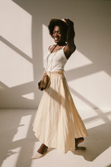 Cheerful black woman in summer outfit