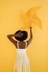 Anonymous black woman with pinwheel