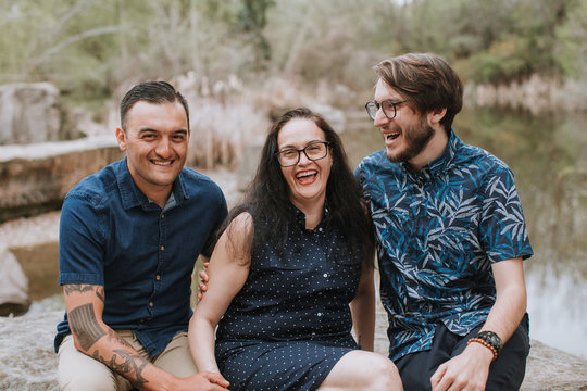 Portrait of Happy, Smiling Family - Mom with Two Adult Sons