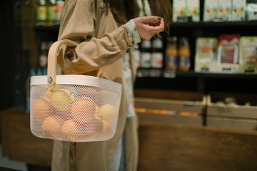 Midsection of woman shopping in supermarket