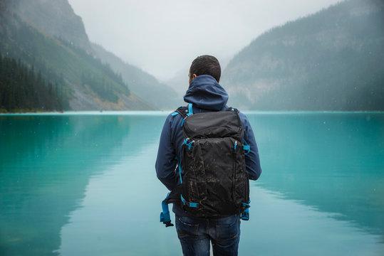Young man enjoying the awesome view. Lake Louise, Alberta, Canadian