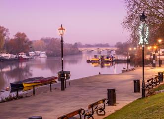 Small harbor on Richmond Thames riverbank and path walk illuminated at twilight in England - UK