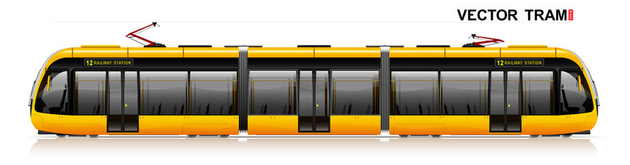 Fototapeta The modern city tram is yellow. Side view. Eco-friendly electric transport. Way to work and home.