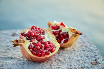 ripe organic pomegranate on the stone background