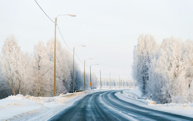 Winter road with snow in Finland. Cold landscape of Lapland. Europe forest. Finnish City highway ride. Roadway and route snowy street trip. Driving