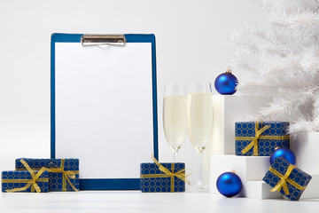 Gift boxes,  champagne,  blank clipboard and Christmas ornaments