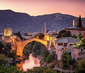 Foto auf Acrylglas Aubergine lila Amazing Mostar Bridge in sunset colors
